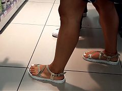 Her sexy legs long feets toes in sandals