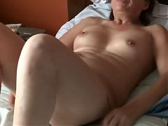 Aroused 58 year old mom takes off her clothes to masturbate