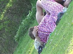Young couple cudling on the grass
