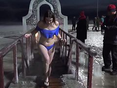 Women ice swimming in winter